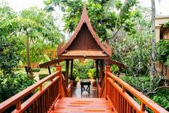 Wooden bridge, walkway, through Thai style pavilion, Royalty Free Stock Image