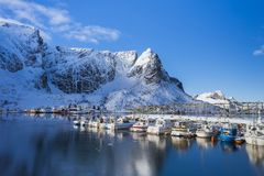 Wooden bridge on the water leading to the village on Lofoten Islands in Norway stock photography