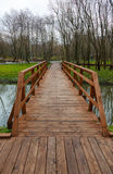 Wooden bridge and water Royalty Free Stock Image