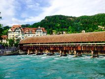 Wooden bridge and water in Thun Royalty Free Stock Photos