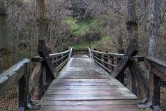 Wooden bridge. Wet wooden bridge in the rain in Segovia not far from Alkazar, Spain Royalty Free Stock Photos