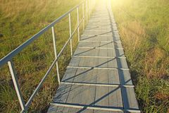 A wooden bridge or a wooden road for people to cross.  royalty free stock photography