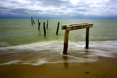 Wooden bridger on sea coast Royalty Free Stock Photo