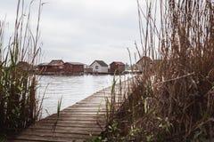 Wooden bridges on the Lake Bokod. Fishing wooden cottages, Hungary royalty free stock image