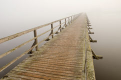 Wooden brigde  and  morning mist Stock Images