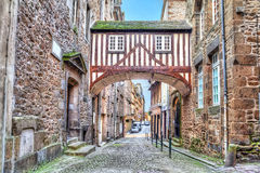 Wooden brigde on narrow street in Saint-Malo Stock Images
