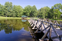 Wooden brigde on resort lake water Royalty Free Stock Photos