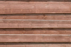 Wooden brown background of boards. Royalty Free Stock Photo