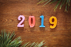 Wooden brown background about Happy New Year 2019 Stock Photos