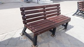 Wooden bench in the street royalty free stock images