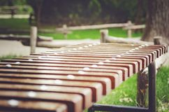 A wooden brown bench in the park, close-up. Wood texture stock images