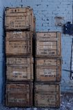 Wooden brown boxes in stock for storage Stock Images