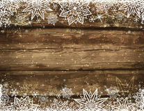 Wooden brown christmas background with snowflakes and stars royalty free stock images