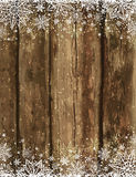 Wooden brown christmas background with snowflakes and stars stock images