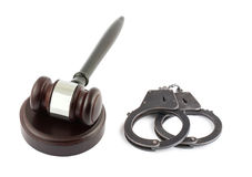 Wooden brown gavel and handcuffs Stock Photos