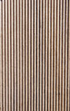 Wooden brown grooves panel closeup Royalty Free Stock Photos