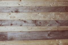 Wooden brown knotty rough planks texture Stock Photography