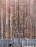Wooden brown, old and peeled background. Close up view with details. Space for text. Wooden brown, old and peeled door for backdrop. Close up view with details Royalty Free Stock Photography