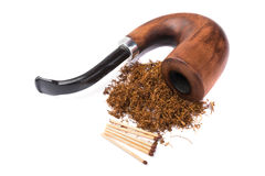 Wooden brown  pipe with dried tobacco leaves Stock Photo