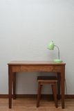Wooden Brown Table with a Lamp. In bedroom Stock Photography