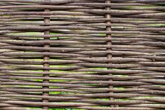 Wooden brown texture of thin rural fence rods Stock Photos