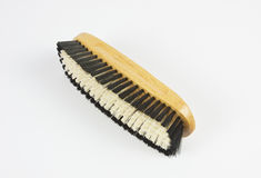 WOODEN BRUSH WITH BLACK WHITE HAIR Stock Image