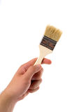 Wooden brush in hand of man Stock Images