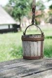 Wooden bucket Stock Images