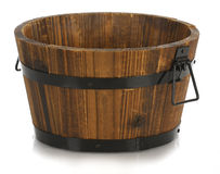 Wooden bucket. With reflection on white background Stock Photography