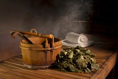Wooden bucket and couch in the Russian bath. royalty free stock images