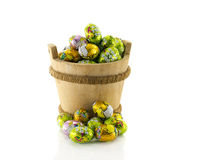 Wooden bucket with easter eggs Royalty Free Stock Images