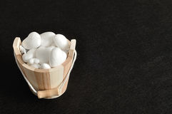 A wooden bucket filled with polystyrene hearts Royalty Free Stock Photos