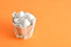 A wooden bucket filled with polystyrene hearts Stock Image