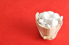 A wooden bucket filled with polystyrene hearts Royalty Free Stock Photography