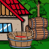Wooden bucket full of red liquid in front of a house Stock Images