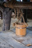 Wooden bucket on the groundwater well. Wooden bucket standing on the cover of groundwater well stock photography