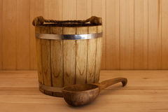 Wooden bucket with ladle Stock Images