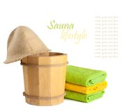 Wooden bucket with ladle for the sauna Stock Photos