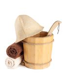 Wooden bucket with ladle and towels for the sauna Stock Photography