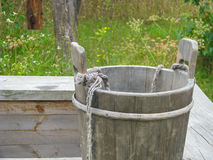 Wooden bucket on the old well Royalty Free Stock Photos