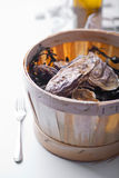 Wooden bucket with oysters Stock Images