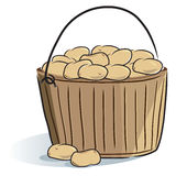 Wooden bucket potatoes Stock Photos