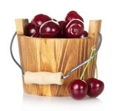 Wooden bucket with red ripe sweet cherry and some Stock Photos