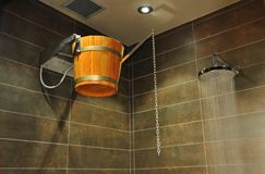 Wooden bucket in shower Royalty Free Stock Image