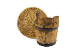 Wooden bucket and straw bowl Stock Images