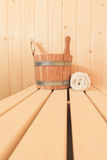 Wooden bucket and towel Stock Photo