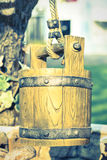 Wooden bucket in vintage style color. Royalty Free Stock Images