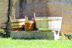 Wooden buckets and tubs in the courtyard of fortresses Guaita on Stock Photos