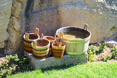 Wooden buckets and tubs in the courtyard of fortresses Guaita on. Mount Titan. The Republic of San Marino Stock Image