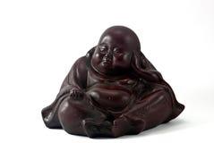 Wooden Buddha. Fat wooden dark brown buddha statue  on a white background Stock Image